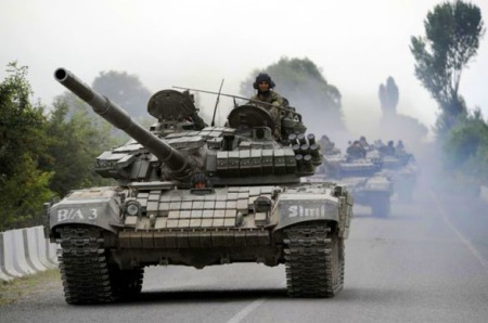 GEORGIAN TANKS MOVE ALONG A ROAD NEAR THE SOUTH OSSETIAN CAPITAL