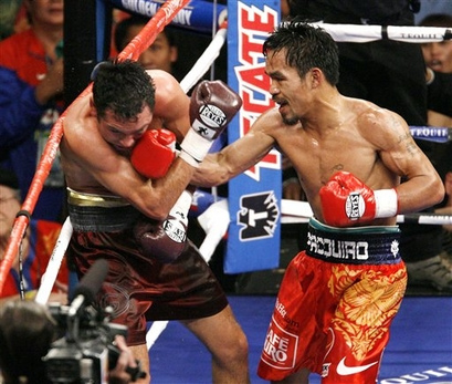 THE PACMAN DELIVERS A BLOW TO THE GOLDEN BOY