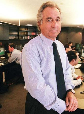 BERNARD MADOFF AT HIS SECURITIES OFFICE IN HAPPIER DAYS WHEN HE WAS CONSIDERED TO BE A FINANCIAL MAVEN AND A BIG MACHER; HE HAS BEEN REDUCED TO THE STATUS OF A MOMZER NOW THAT HIS TRUE CHARACTER HAS BECOME KNOWN