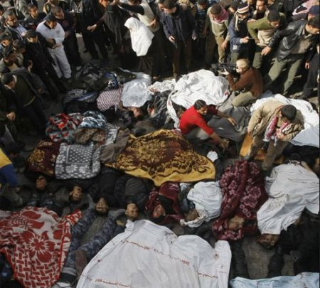 BODIES FROM THE SITES OF ISRAELI AIR STRIKES ARE LINED UP AT A HOSPITAL IN GAZA